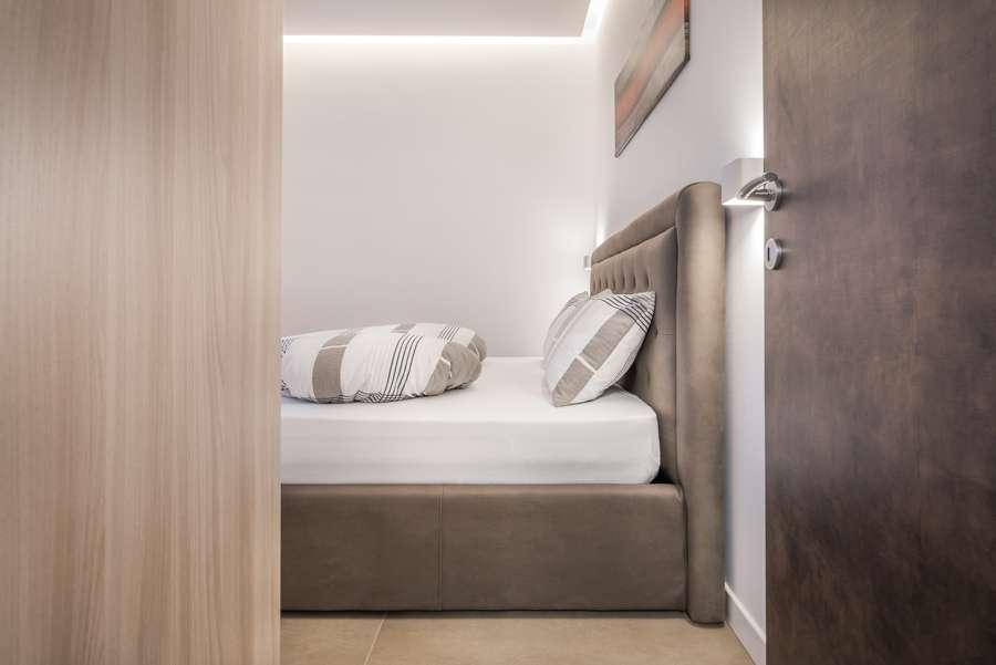 camera da letto appartamento a Merano